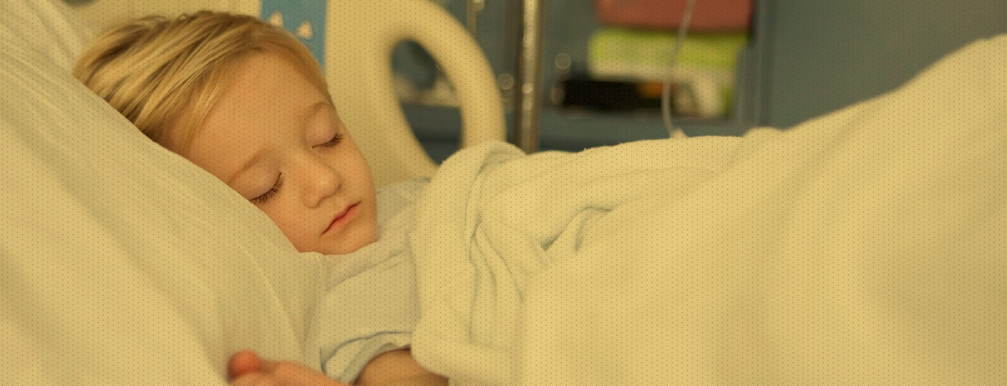 Young girl resting in hospital bed