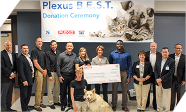 Winning team members of a Plexus continuous improvement competition selected a local animal shelter to receive a monetary contribution
