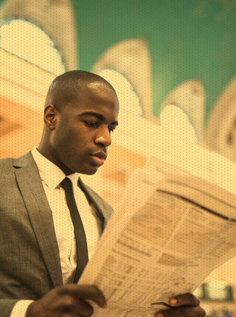 Male in suit reading a newspaper